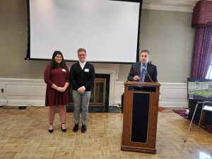 IU University Club 2019 Scholarship Program - IMU Executive Director Hank Walter introducing the scholarship recipients Haley Parrish and Jason Wendt